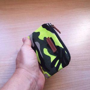 yelow camo wallet held in hand