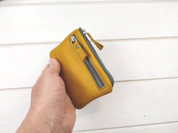 mustard pocket wallet held in hand