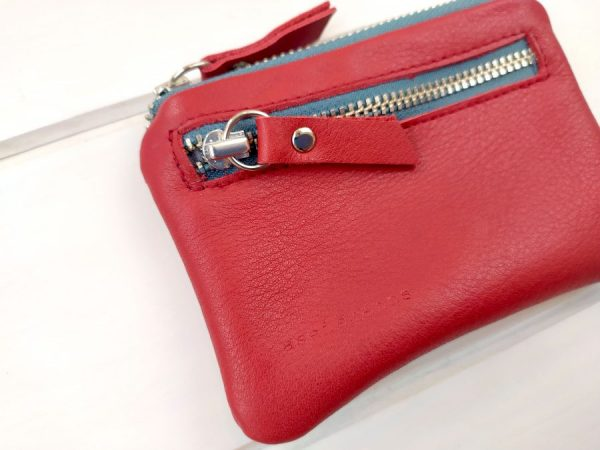red leather pocket wallet front close view