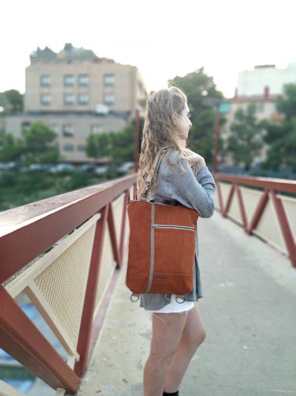 wearing backpack as a shoulder bag