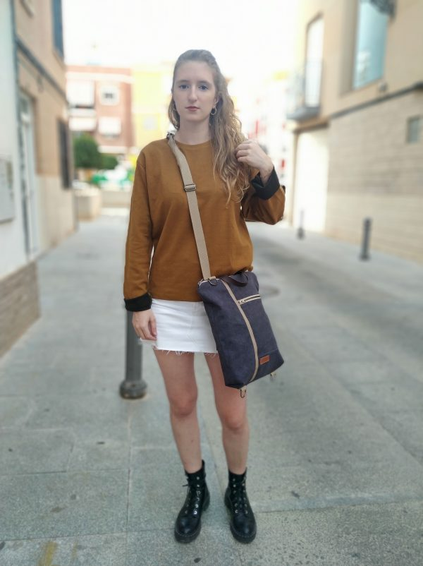 wearing backpack as a crossbody