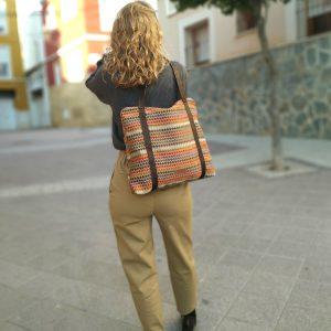 tote bag holding at model's back