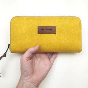 yellow aseismanos wallet held in hand