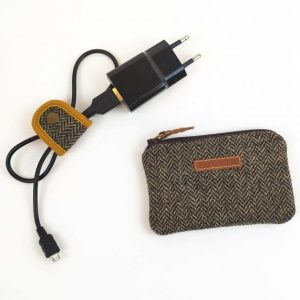 photo showing coin purse and cable holder with charger