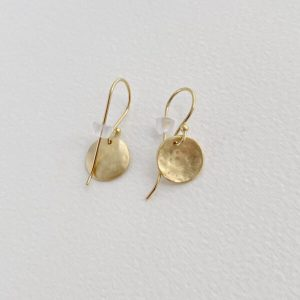 small gold earrings on a surface