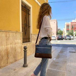 girl wearing bag on her shoulder