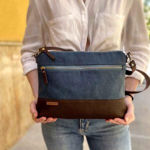 Crossbody canvas day bag held in hands